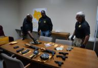 Orangeburg County sheriff looking at items on a table